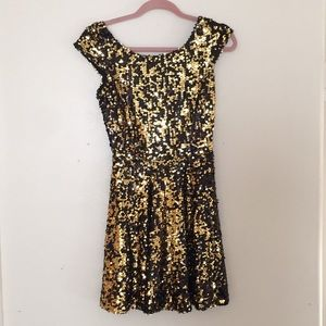 Backless black and gold sequin dress.
